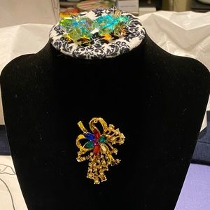 Two beautiful festive pieces, earrings and broach